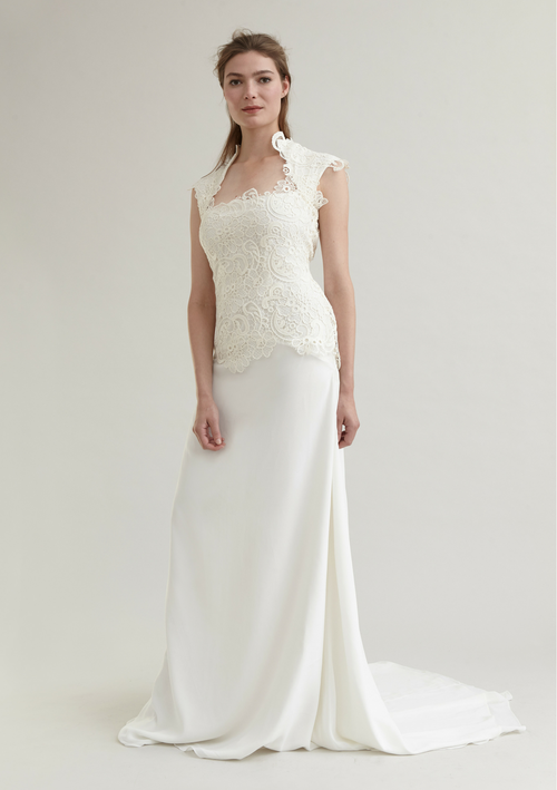 White bridal gown detailed with floral pattern lace bodice and a small train