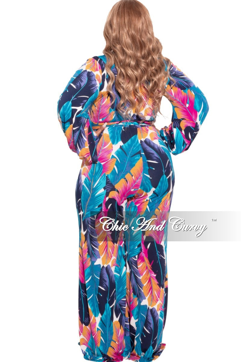 *Final Sale Plus Size Long Sleeve Faux Wrap Jumpsuit with Attached Tie and Back Gold Zipper in Navy/Fuchsia Palm Print