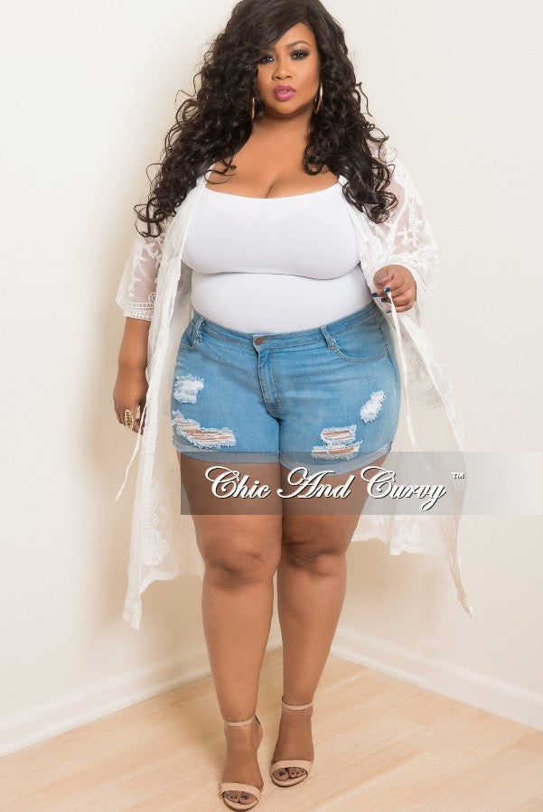 new plus size denim shorts with ripped front in light blue – chic