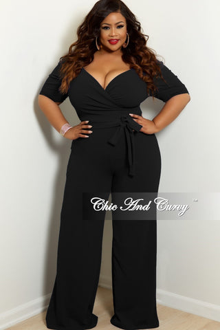 03d04771cc7f7 New Plus Size Faux Wrap Jumpsuit with Puff Sleeves and Attached Tie in  Black.   68.00. New Plus Size 2-Piece Faux Wrap Sleeveless Deep V Top and Pants  Set ...