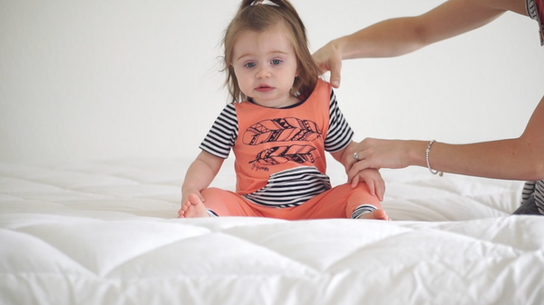 how to put on a baby romper from Gigi and Max