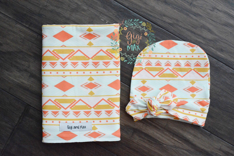 "Swaddle peach mint Aztec 34"" x 34"""