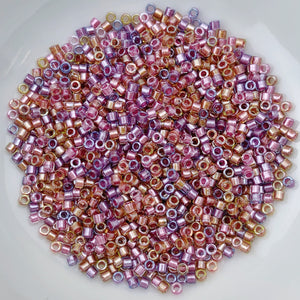 11/0 Delica - Spkl Lined Tutti Frutti Mix (purple rose gold) DB0982 - The Bead N Crystal & Enclave Gems