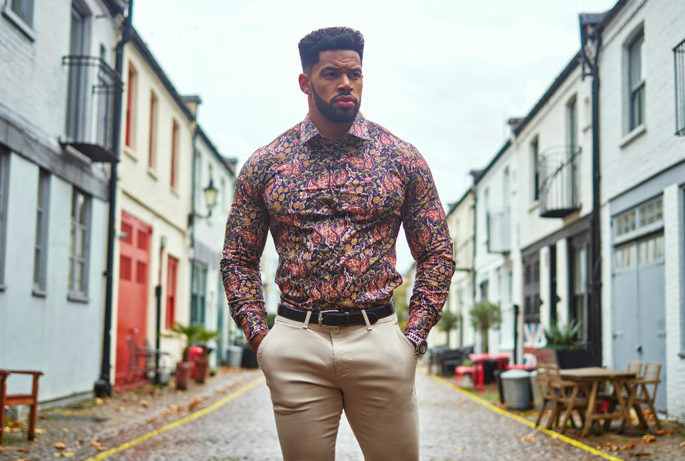 bodybuilder in floral shirt and tan chinos