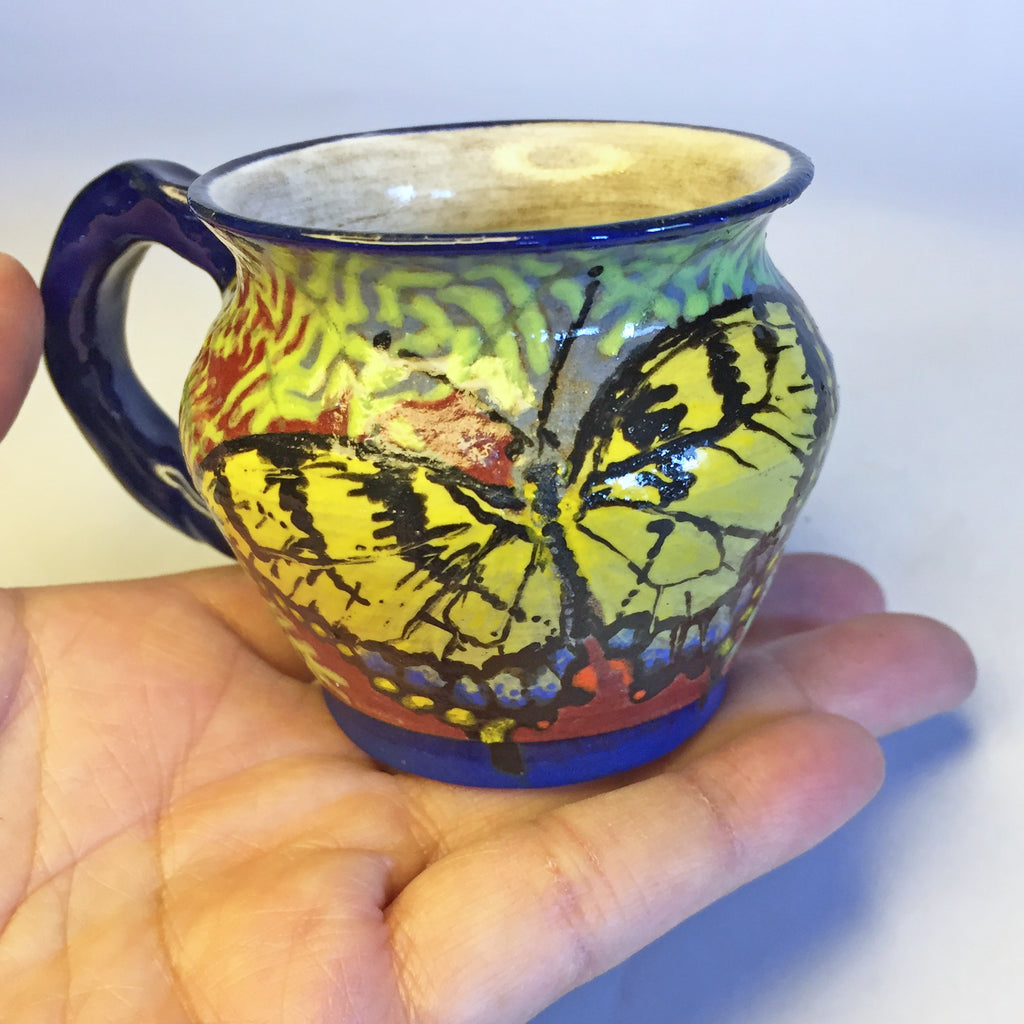 Tiny Teacup Covered in Vibrant Butterfly & Floral Design!