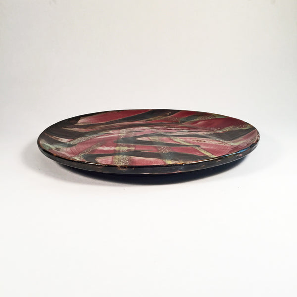 Exquisite Handmade Ceramic Plate with Unique Multi Color Glaze Design.