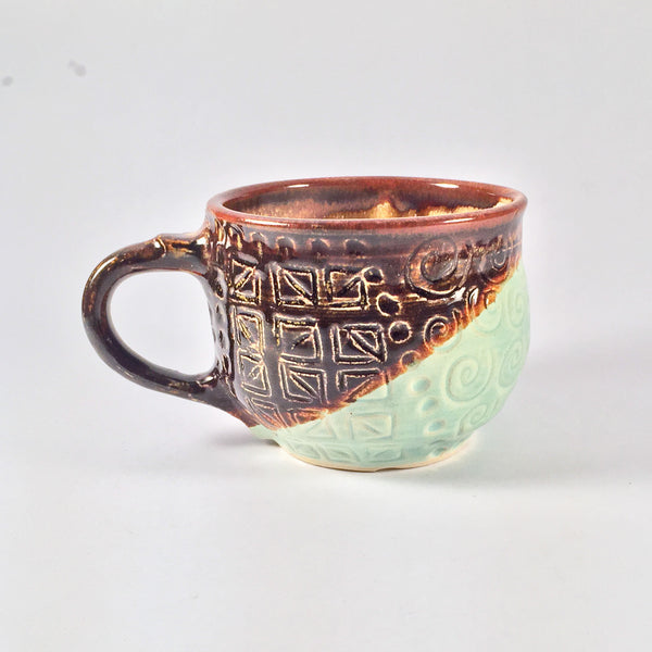 Unique, Sgraffito Mug has Etched Design and Diagonally Layered Glazes.