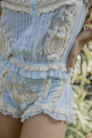 Boho style light blue top and light blue shorts