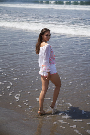 White blouse and shorts with pink and golden embroidery