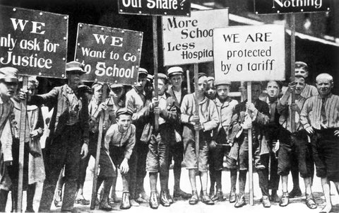 Image of children on strike for labor rights.