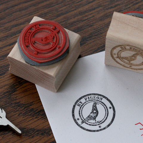 """By Pigeon"" rubber stamp with image of pigeon."