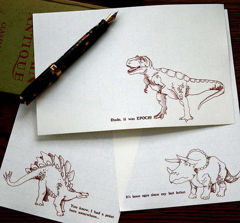 Stationery set with three dinosaur illustrations and puns.