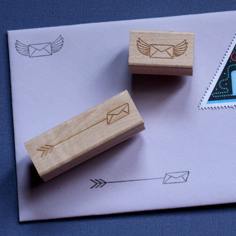 Two rubber stamps with envelope designs.