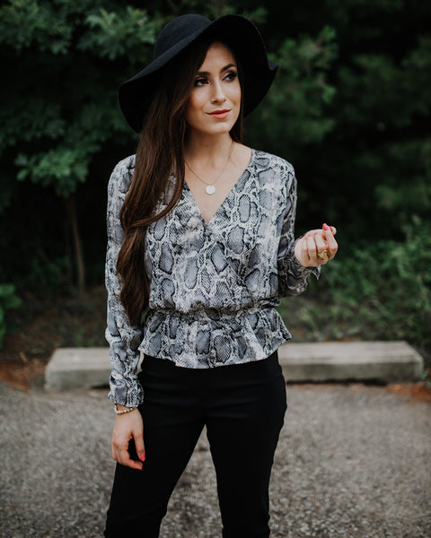 Snake Eyes Peplum Blouse