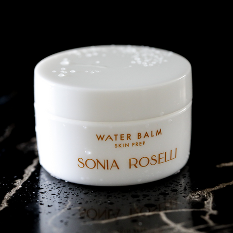 Water balm stylized shot with black marble background