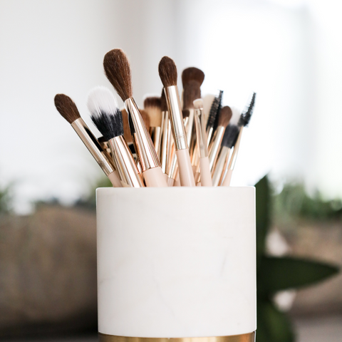 Makeup brushes sitting in a container