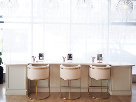 Salon chairs and vanities in a row
