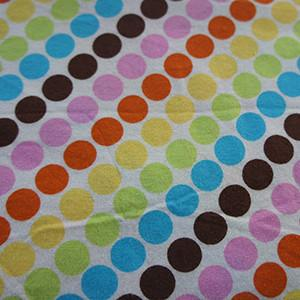 Multicolor Rainbow Dots on White Cotton Jersey Knit Fabric