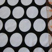 Mega White Dots on Black Polyester Rayon Lycra Jersey Knit Fabric