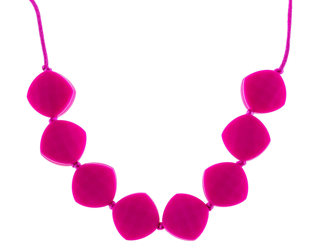 teething pains reduced with fun bright pink chewable teether