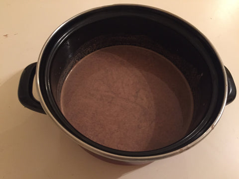 Chocolate and a bit of milk and water on a heated pot
