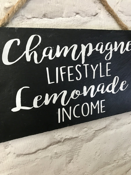 Champagne lifestyle, lemonade income slate sign