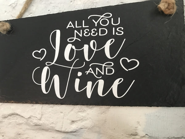 'All you need is love and wine' slate sign