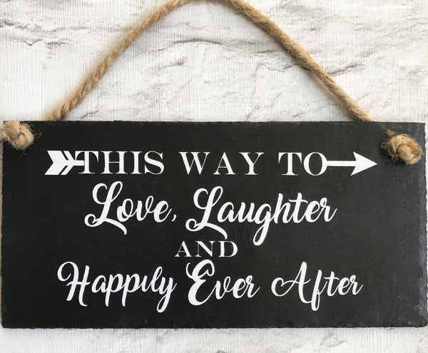 Wedding sign - 'This way to Love, Laughter and Happily Ever after'