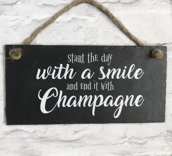 Champagne  slate sign ' Start the day with a smile and end it with Champagne'