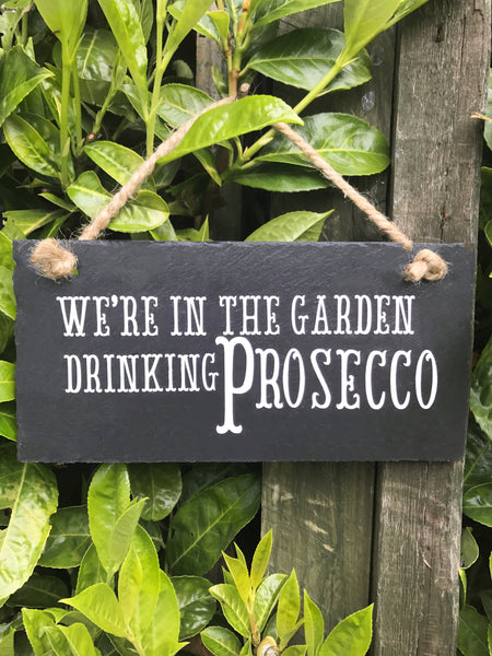 'We're in the garden drinking Prosecco' slate sign