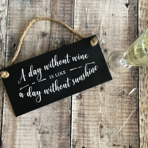 Wine quote sign -  'A day without wine is like a day without sunshine' - Lilybels
