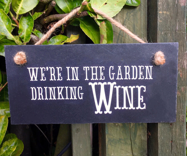 'In the garden drinking wine' hanging sign