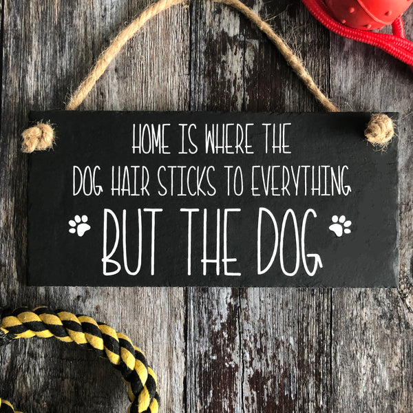 Dog fur -  Dog quote. 'Hair sticks to everything but the dog' slate sign