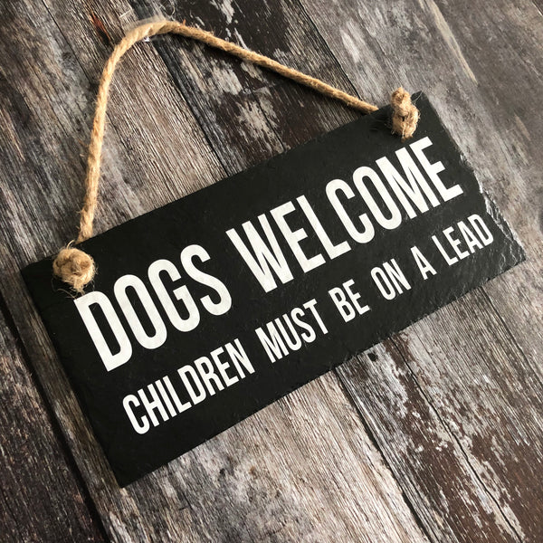 Dogs welcome sign. Children must be on a lead