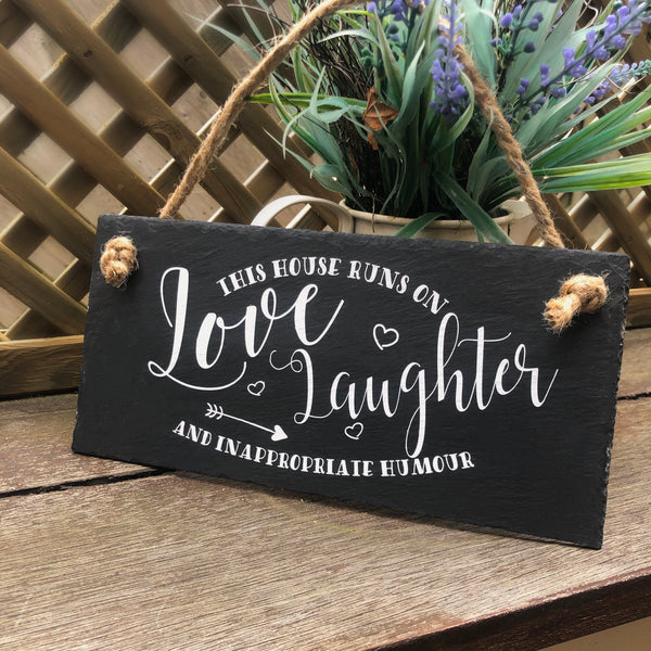 This house runs on love laughter and inappropriate humour, hanging slate sign