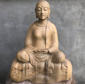 Patacara A Buddhist nun from the time of the Buddha. Beautiful serene face. Seated in Meditation Light colored hibiscus wood with grey tones.
