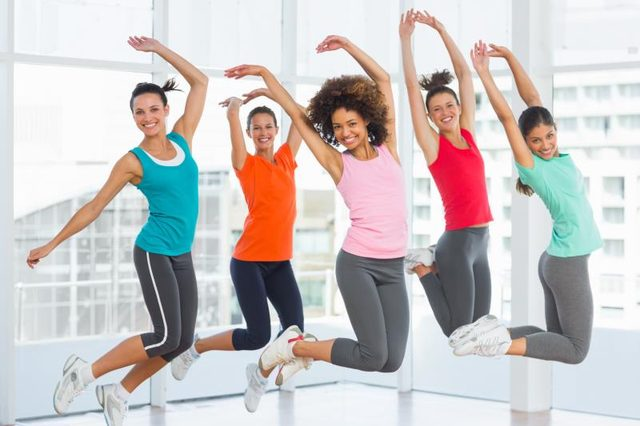 Exercises to Avoid If You Have Bad Knees: Women in a gym jumping.