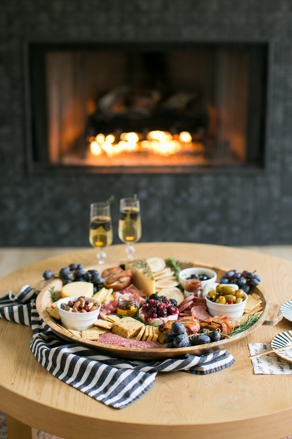 New Year's Eve Charcuterie Board with Bacon Wrapped Pears and Blackberry Champagne Cocktail