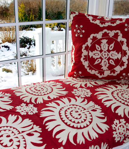 Red and white suzani pillow and decor
