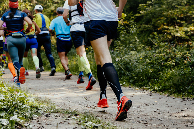 Group of trail runners wearing compression socks