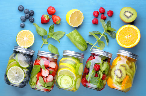 fruit and water filled bottles