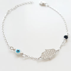 925 STERLING SILVER BRACELET WITH HAMSA HAND PAVED WITH CZ CRYSTALS AND TURKISH EVIL EYE CHARM.