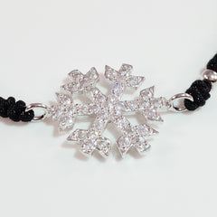 925 STERLING SILVER CZ CRYSTAL SNOWFLAKE ON THREADED BRAIDED BRACELET.
