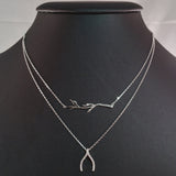 925 STERLING SILVER DOUBLE LAYER NECKLACE WITH CRYSTAL WISHBONE AND TREE BRANCH PENDANT.