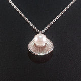 925 STERLING SILVER NECKLACE WITH GENUINE FRESHWATER PEARL SET IN SEA SHELL PENDANT.