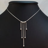 925 STERLING SILVER NECKLACE WITH FIVE FLOATING DROPS.