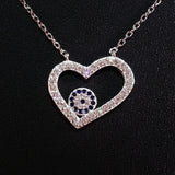 925 STERLING SILVER NECKLACE WITH OPEN HEART EVIL EYE PENDANT SET IN SPARKLING CRYSTALS.