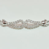 925 STERLING SILVER BRACELET WITH ANGEL WINGS CHARM PAVED WITH  SPARKLING CZ CRYSTALS.