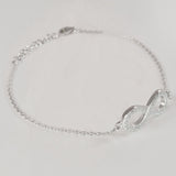 925 STERLING SILVER BRACELET WITH ETERNITY CHARM PAVED WITH  SPARKLING CZ CRYSTALS.