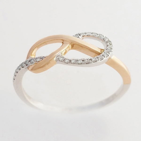 9K SOLID ROSE GOLD & WHITE GOLD INFINITY RING WITH 26 DIAMONDS.